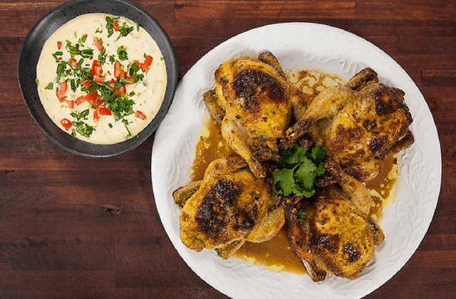 Spiced roast poussin with saffron, garlic yoghurt